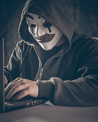 Computer Hacker sending phishing email